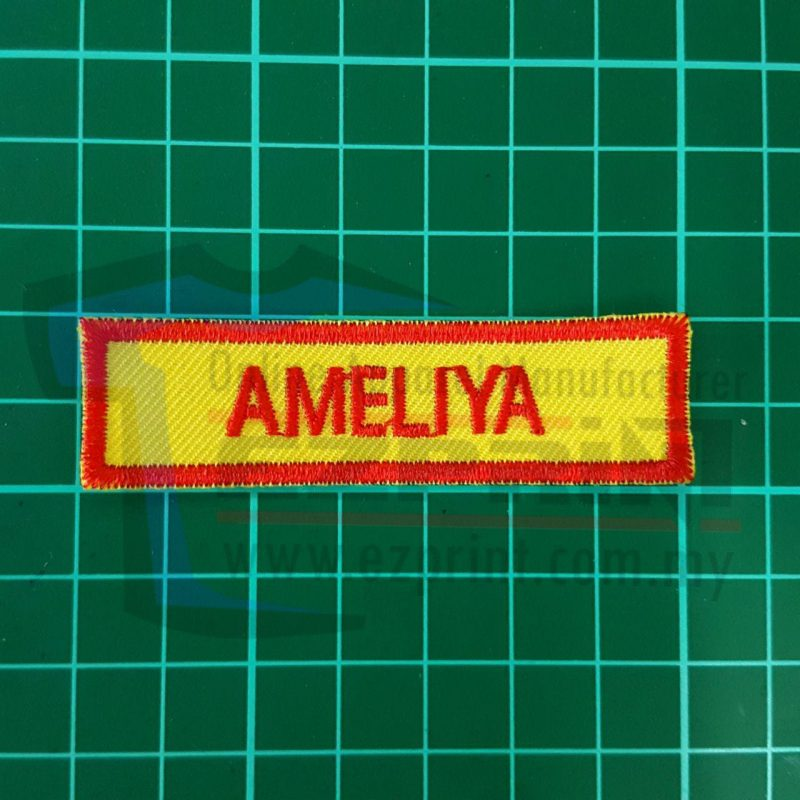 name tag embroidery yellow red